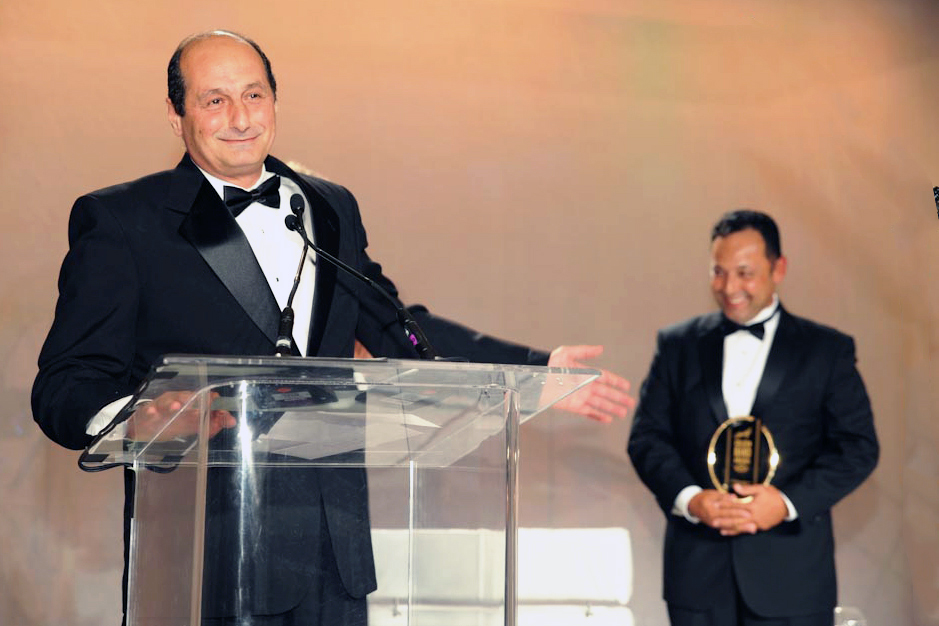 Davidoff Appointed Merchants | Ammar Tabbaa, owner of Maxamar Ultimate Cigars, accepting the Appointed Merchant award at the Golden Band Awards ceremony in 2013. Eliseo Gonzalez, a sales manager for Davidoff, is in the background.